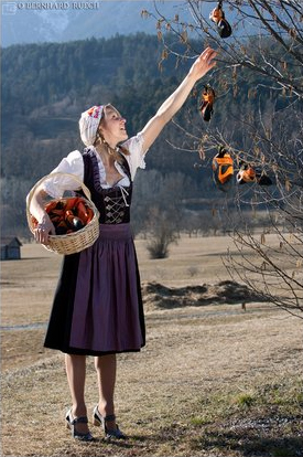 Reaching up - Angy picks some ehrm… shoes in a traditional Tyrolean dress © Bernie