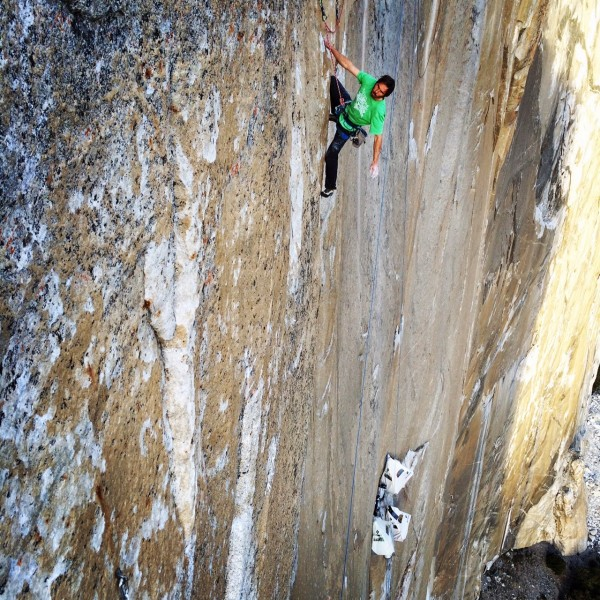 Kevin leading the 15th pitch, with the portaledges down below © Corey Rich